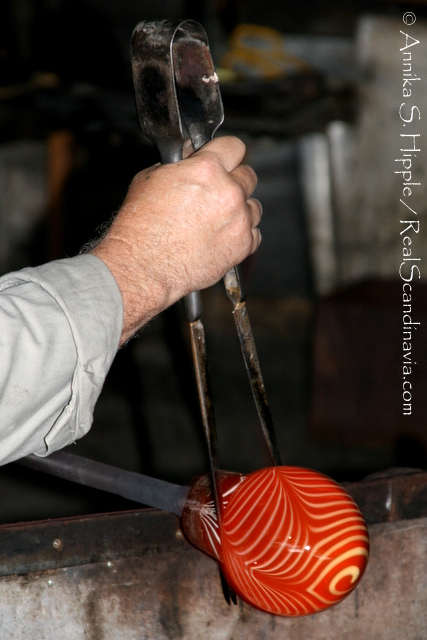 Working the molten glass.
