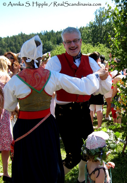 Dancers in folk costumes on Midsummer's Eve