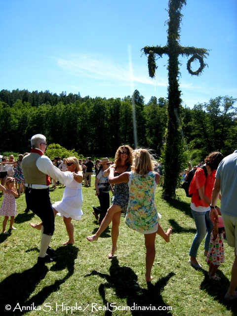 Dancing round the maypole on Midsummer's Eve